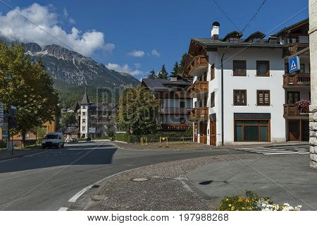 Autumnal corso Italia, the residential district in the town Cortina d'Ampezzo with mountain, Dolomites, Alps, Veneto, Italy, Europe