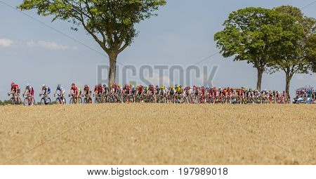 Vendeuvre-sur-Barse France - 6 July 2017: The peloton passes through a region of wheat fields during the stage 6 of Tour de France 2017.