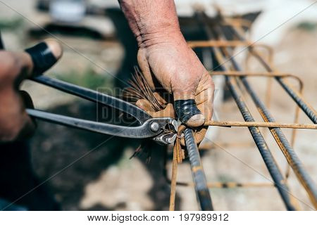 Armature Bars In Construction Site, Hands Of Builder, Construction Worker On Site