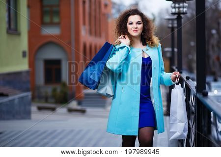 Happy Smiling Attractive Young Woman With Paper Shopping Bags Wa