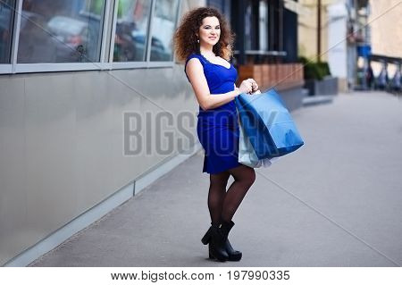 Happy Smiling Attractive Young Woman With Paper Shopping Bags In