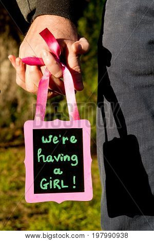 We Are Having A Girl - Announcement Message For Expecting A New Baby Girl - Holding Hands With Handw