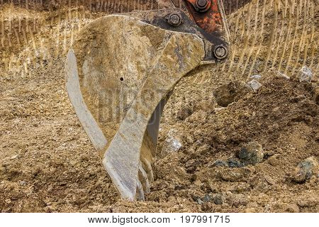 Excavator Bucket With Yellow And Brown Dirt Texture Background