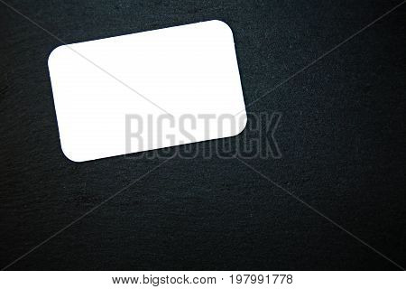 Blackboard (slate) with blank, white writable notepad