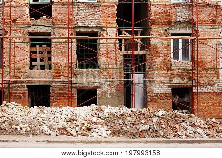 Process Of Reconstruction Of An Old Building. Ruined Walls, Bric