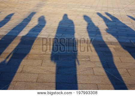 People Shadows On The Pavement