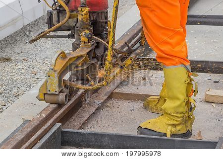 Rail Worker Grinding Tramway Track