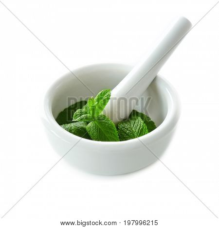 Mortar with leaves of lemon balm on white background