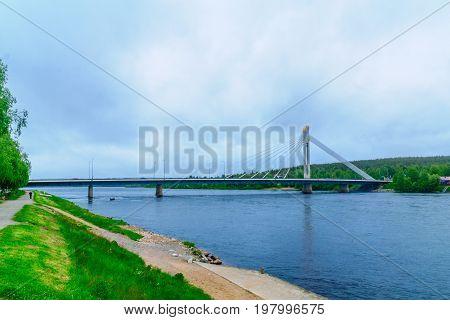Lumberjacks Candle Bridge And The Kemijoki River In Rovaniemi