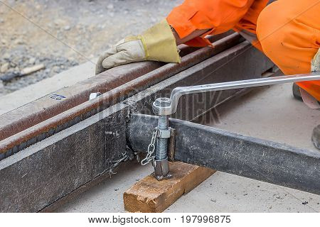 Rail Worker Tightening A Bolt Using Wrench 2