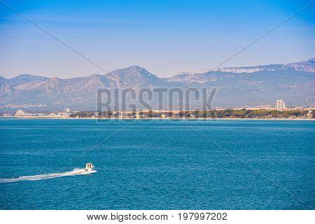 White yacht on mediterranean sea Costa Dorada Tarragona Catalanya Spain. Blue sky. Copy space for text