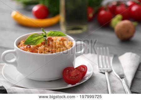 Ceramic pot with turkey casserole on table