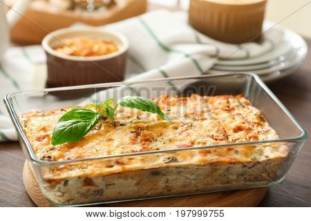 Baking tray with delicious turkey casserole on wooden table
