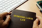 A Book with title overtime labor law. poster