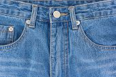 Denim jeans texture or denim jeans background with old torn. Old grunge vintage denim jeans. Fade texture denim jeans . poster