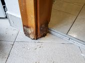 Door frame damaged by water. Wood rotting away. poster