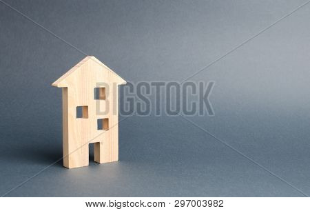 Multi-storey Building Residential House On A Gray Background. Mortgage And Credit For The Purchase.