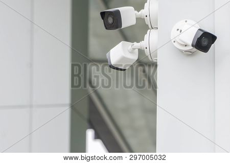 Outdoor Cctv Security Cameras Installed On The Modern White Building Wall In The City. Concept Of Su