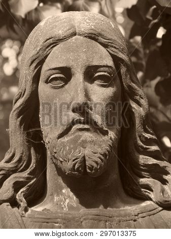 Christus face on grave in old abadoned cemetary, Detail of statue poster