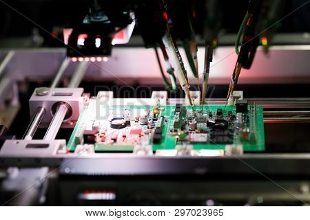 Printed Circuit Board Assembly During A Flying Probe In-circuit Test On Flying Probe Tester System.