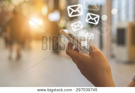 Close-up Image Hand Using Smartphone With Icon Envelope Email. Contact Us Customer Service Or E-mail