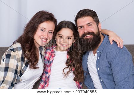Friendly Family Sit Couch Posing For Photo Family Album. Mom Dad And Daughter Smiling Relaxing On Co