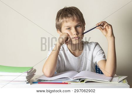 Sad Tired Boy Doing Homework. Education, School, Learning Difficulties Concept
