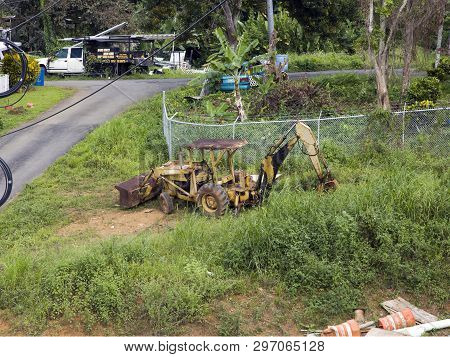 Cerro Gordo, Bayamon/puerto Rico - February 22, 2019: Rusted Ford Holland Case Loader Tractor Backho