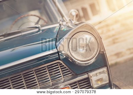 Detail Of A Vintage Car. Close Up Of Headlight Retro Classic Car. Vintage Effect Style Pictures. Cla