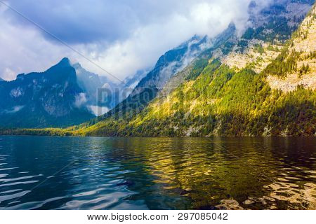 The lake is surrounded by high mountains. Königssee - the cleanest lake in Germany. Mountain Lake is a fabulous beauty in Bavaria. The concept of active, ecological and photo tourism