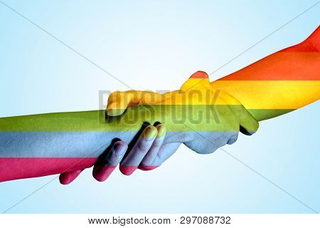 Two Gay Couple Hands With Rainbow Flag Skin Holding Each Other By The Wrists Over Bright Background.