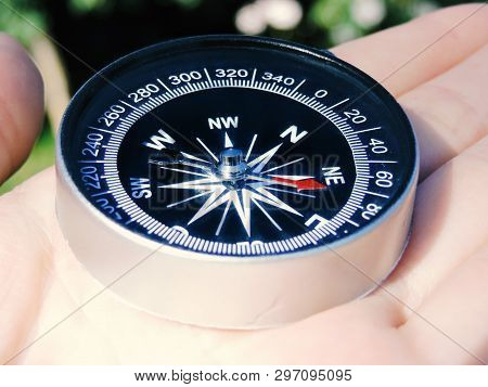 Man Explorer Searching Direction With Compass. Compass In The Hand,tourism And Exploration. Macro Ph