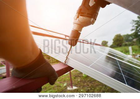 Close-up Angled View Of Technician Working With Screwdriver Connecting Solar Photo Voltaic Panel To