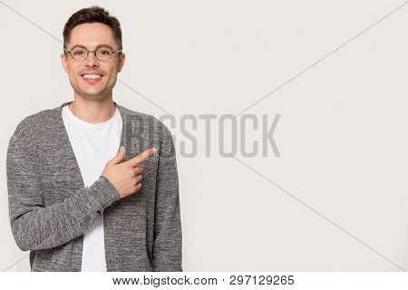 Smiling Caucasian Man In Glasses Pointing At Copy Space Isolated