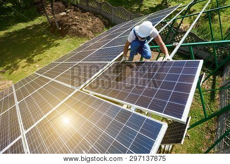 Risky Work: Mounting Solar Batteries On Green Metallic Carcass. Environment Friendly, Green Energy.