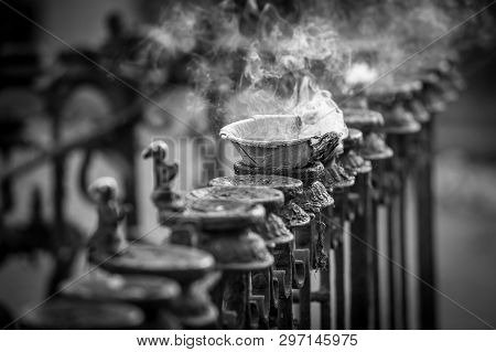 Close Up Of Oblations Of Food And Flowers To Their Goods, Kathmandu, Nepal, Asia. Fire In The Bowl F