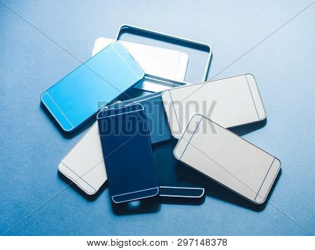Case Cover For Smartphone. Plastic Accessories Waste. Heap Of Cheap Low Quality Products Equipment.