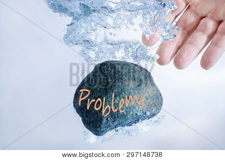 Stoke A Stone With Problems. Concept Solution To The Problem, Difficulty, Crisis.