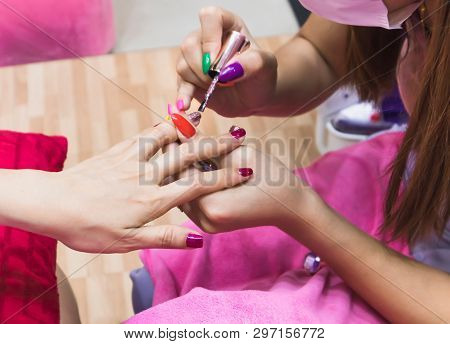 Close Up Of Female Hands Applying Pink Color