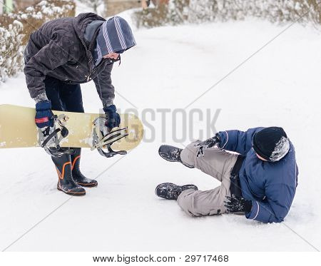 Boy helps another one during snow game accident. poster