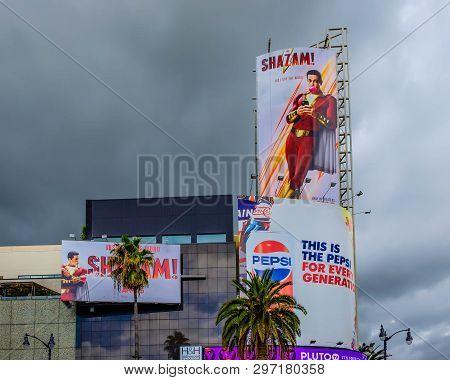 Los Angeles, California, March 2019, billboards on the corner of Hollywood Blvd & Highland Av