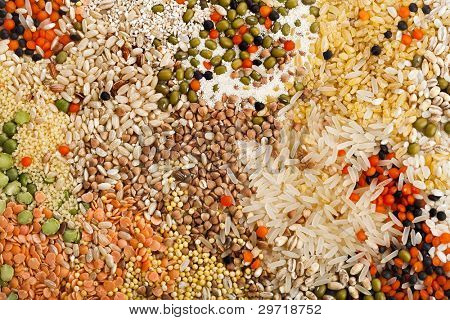 mixture of dry lentils, beans, peas, soybeans,groats,  grain ,legumes in wooden box