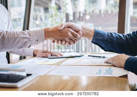 Finishing Up A Conversation After Collaboration, Handshake Of Two Business People After Contract Agr