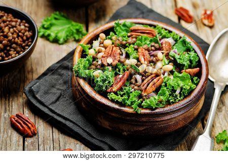Kale Pecan White Beans Lentils Salad On A Wood Background