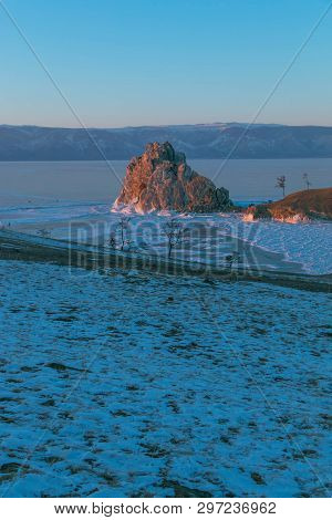 Vertical Image Of Cape Burkhan On Northern Olkhon Island In Winter That Water In The Lake To Be Ice