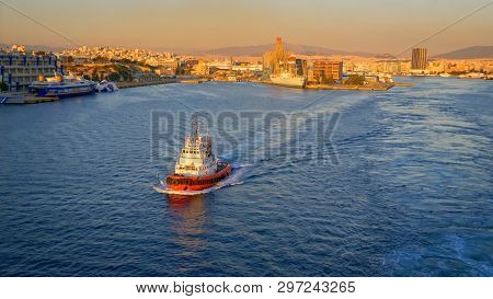 Port Of Piraeus With Athens, Greece Skyline. The Largest Greek Seaport, Ship Logos Removed Or Blurre