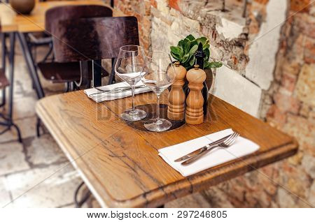 Tables In The Restaurant In The Open Air. Ancient Stone Buildings On The Streets Of Split In Croatia