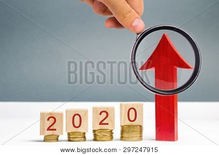 poster of Wooden blocks 2020 and red arrow up. Concept of business and finance. Planning. Investing in the future. Action plan. Investment and banking. Startup. Tax increase. Pension payments. Rise. Growth