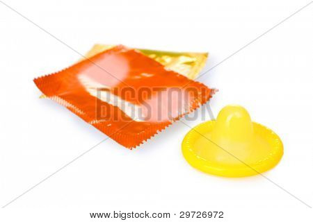 Yellow condom with  packs isolated on white