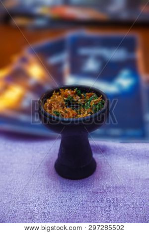 the embers in the bowl of the hookah. close-up